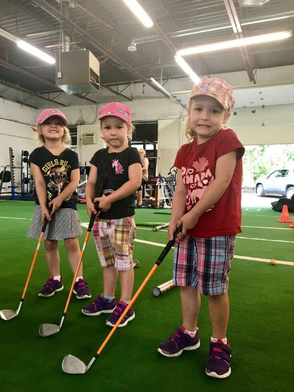 Three young golfers