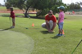 young kids learning golf
