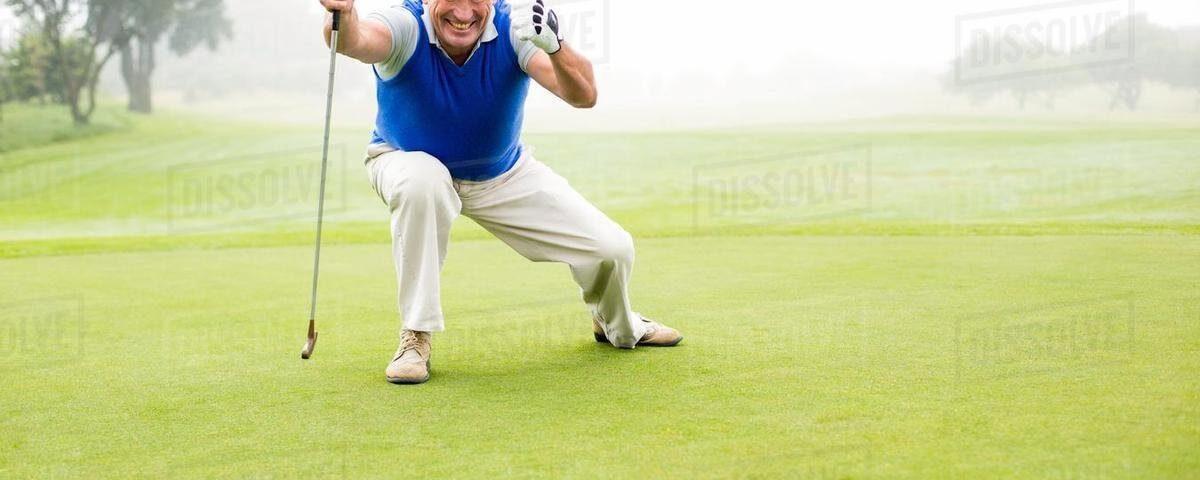 a golfer celebrating watching his putt