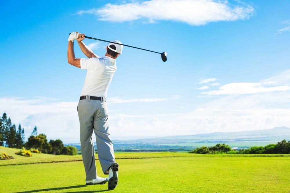a golfer teeing off