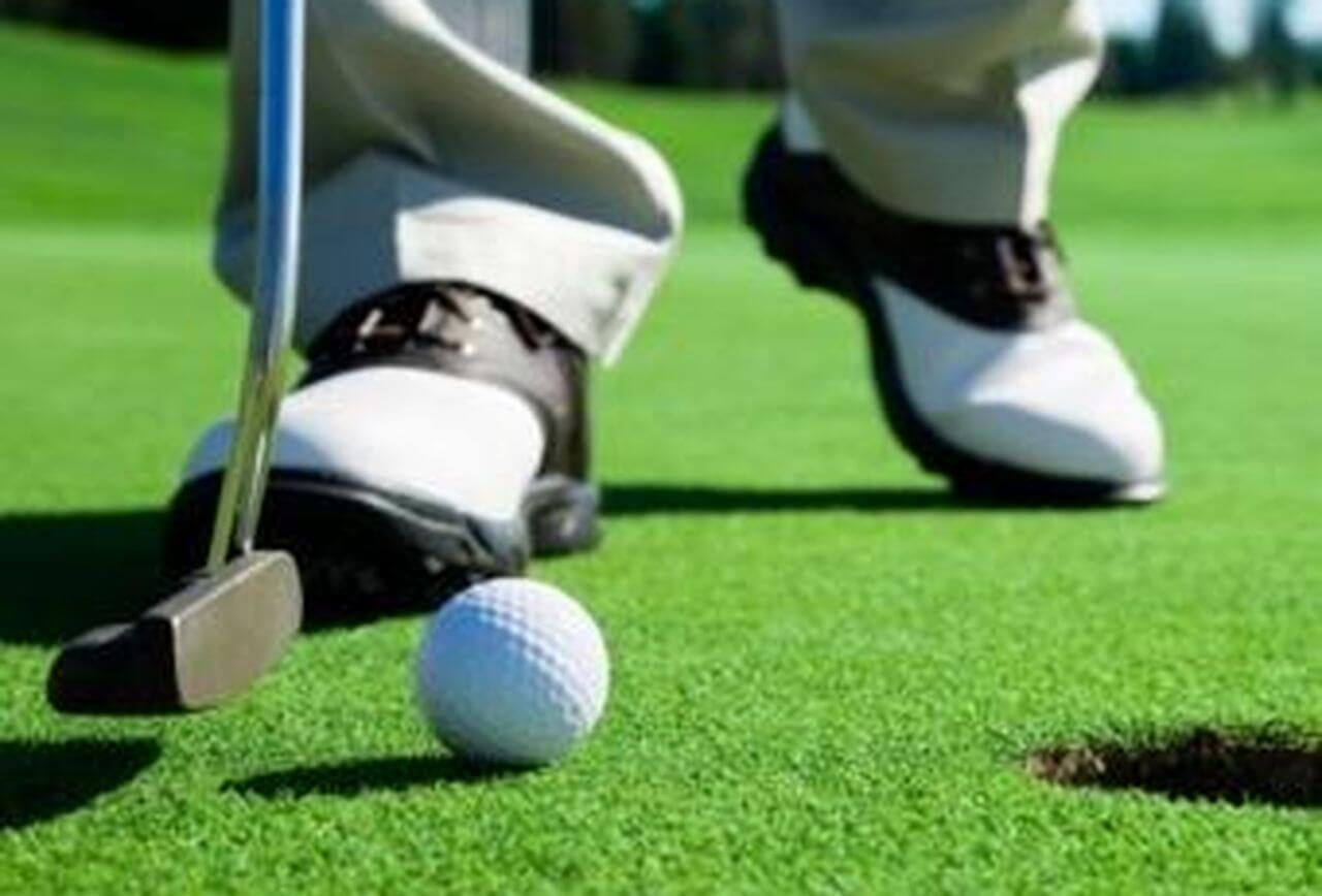 A golfer getting ready to putt